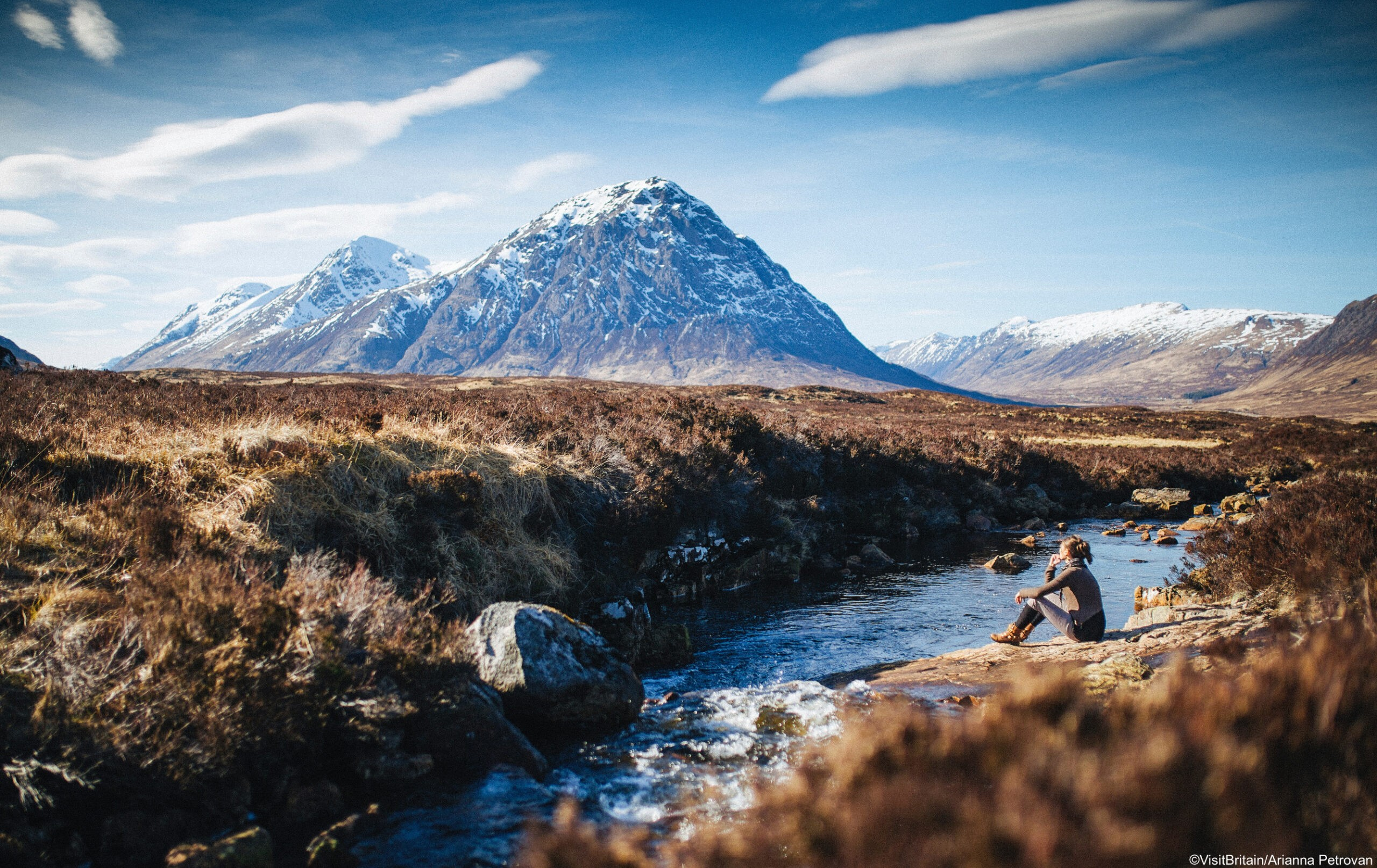 A person sitting enjoying the view, Glencoe, Scotland